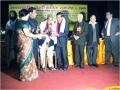 १४ दिसम्बर २००९ को लखनऊ में पद्मभूषण डा० गोपालदास 'नीरज' द्वारा सम्मानित होते अन्तर्राष्ट्रीय हिन्दी समिति वाशिंगटन शाखा के श्री धनंजय कुमार तथा सचिव श्री सतीश मिश्रा